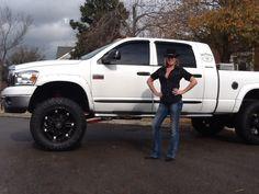 white lifted dodge ram truck