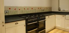 The amount of our kitchen splashbacks in Manchester is growing with the city. Many are getting great bespoke glass art, and this client in Swinton is no different. The Farrow & Ball paint colour Elephant's Breath provides the soft neutral background colour for this modern poppy design splashback in Manchester.