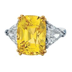 Yellow Sapphire and Diamond Three Stone Platinum and Yellow Gold Ring   From a unique collection of vintage engagement rings at http://www.1stdibs.com/jewelry/rings/engagement-rings/