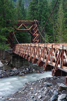 Nisqually River wooden suspension bridge at Longmire village in Mount Rainier National Park, WA USA #scenicwa