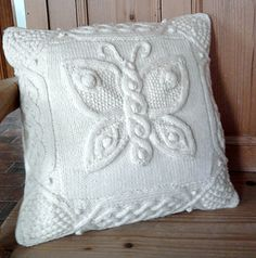 I have previously knitted Barbara A Pott's Celtic oak and Celtic rowan pillows and love them. This time I am trying a different theme with butterflies. I found the butterfly pattern for the c...