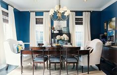 Color Benjamin Moore Champion Cobalt Ashley Putman Gorgeous Blue Brown Dining Room Design With Bold Walls Paint Chair Rail Wood Turned Leg