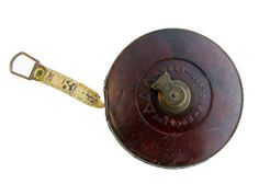 Beautiful old leather measuring tape with handsome coloring and brass detail.