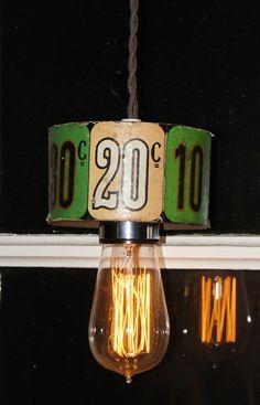 Pendellampor tillverkade av delar från äldre spelautomater via Vintage Lighting. Click on the image to see more!
