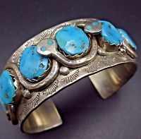 Instantly recognizable, her snakes wrap around stunning blue specimens of old Kingman turquoise. Hand applied stamp work and applied raindrops embellish the face of the cuff. SIGNED: Effie C, for Effie Calavaza (Zuni). Navajo Jewelry, Sterling Jewelry, Ethnic Jewelry, Beaded Jewelry, Sterling Silver, Jewelry Box, Coral Turquoise, Turquoise Jewelry, Turquoise Bracelet