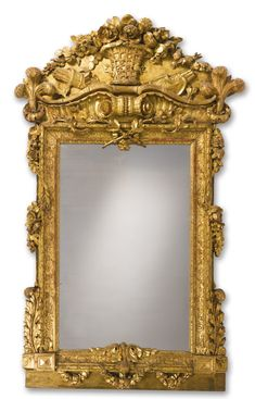 A GERMAN ROCOCO CARVED GILTWOOD MIRROR third quarter 18th Century height 71 1/2 in.; width 45 in