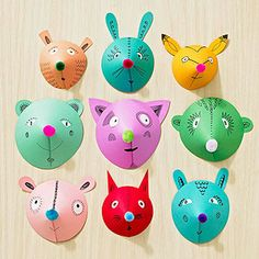 To create a member of this colorful menagerie, cut a circle 4 to 7 inches wide from card stock, then cut a pie slice from the circle. Roll the circle into a cone and secure it with glue dots. Cut out card stock ears. Attach them opposite the seam with tacky glue. Add white office sticker eyes and glue on a pom-pom nose. Draw details with marker. To hang, glue a small rectangle of card stock to the top inside of the cone, fold the flap down, and tack it to a wall.