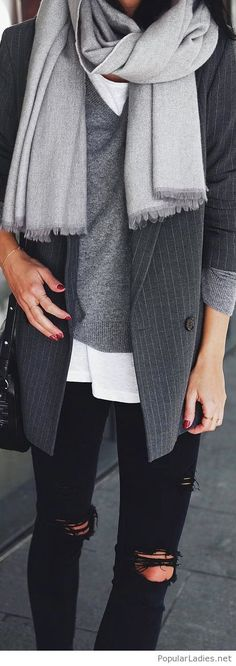 White tee, grey sweater and a blazer