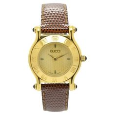 Pre-owned Gucci 6500L Gold Plated / Leather 26.5mm Womens Watch ($196) ❤ liked on Polyvore featuring jewelry, watches, bezel watches, dial watches, gold plated jewellery, preowned watches and gold plated jewelry