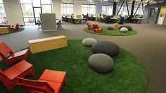 "I've always wanted those Felt Rocks. Skype Offices. The work area features an open floor plan and several comfortable sitting areas for employees to get together and collaborate. The space takes its design cues from the great outdoors; the slate-colored ""rocks"" are actually cushions."