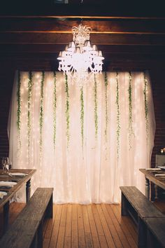 sparkly lights backdrop behind draped tulle - photo by Joyeuse Photography