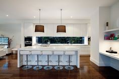 White kitchen with dark wood floors. Thick island bench top made of marble like finish. Glass window splash-back, could possibly achieve a similar look using mirror splash-back. Kitchen Interior, New Kitchen, Kitchen Design, Kitchen Ideas, Study Nook, Kitchen Colour Schemes, Melbourne House, Storey Homes, Wood Windows
