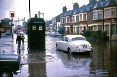 Abbey Wood Station Harrow Manorway leading to Abbey Wood Station is flooded. A real Police call box, not a TARDIS is seen, along with the level crossing. Police Call, Police Box, London History, Local History, Old London, East London, London Bus, Tv Doctors, Doctor Who Tardis