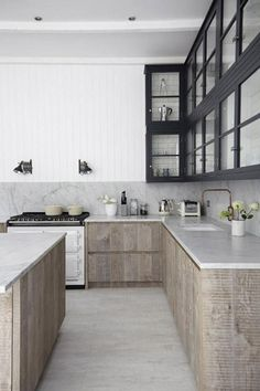 Renovation Inspiration: 12 Beautiful White Marble and Wood Kitchens. Love first profile kitchen if had BIG space