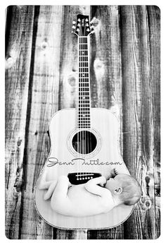 Baby photo with daddy's guitar!