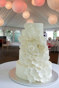 white ruffles white wedding cake