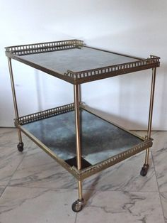 Brass drinks trolley, with eglomized glass. France mid 20th C.