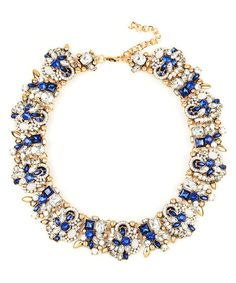 A bevy of glittering crystals sparkles within a shining necklace finished in a warm goldtone.