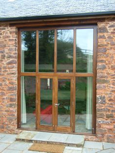 A set of trifold doors incorporated in a barn conversion | Doors |  Pinterest | Barn, Grey exterior and Doors