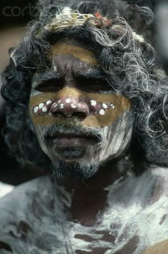 Australia | An aborigine with painted body stands in Arnhem Land. Arnhem Land is the site of the country's largest aboriginal reservation. | © Charles & Josette Lenars