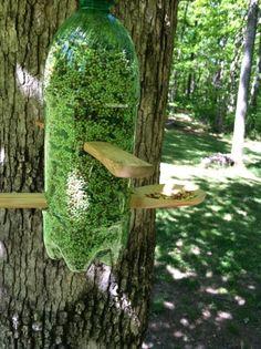 Backyard bird feeder from a soda bottle & wooden spoons!