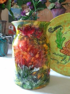 My vases are decorated with alcohol inks on the inside, and outside. I use a museum grade sealant to protect the art. It also allows the vase to be used with water and fresh flowers. This vase sells for $57.00 plus shipping.