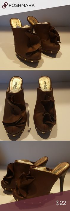 Clog style heels Cute clog styles heels with ruffle like detail...new never worn Charlotte Russe Shoes