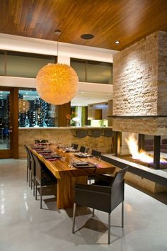 I want the seat next to the fire (or with easiest access to the wine cellar) in this contemporary dining room Contemporary Dining Room Wood Slab Dining Table, Dining Table Design, Dining Room Table, Dining Rooms, Dining Area, Rustic Table, Kitchen Dining, Cozy Kitchen, Dining Room Fireplace