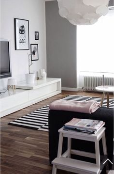 Wooden floor - gray walls - black and white furniture - wooden accents