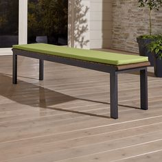 Shop Rocha Dining Bench with Sunbrella ® Cushion.   Three-seat bench with a lightweight aluminum frame finished in a smart charcoal powdercoat is cushioned in Sunbrella acrylic to add comfort while withstanding the elements.