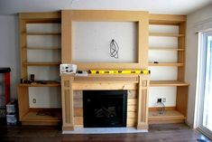 Home Design Drawing fireplace built in shelving 6 - via the sweetest digs - Want to build DIY fireplace built ins? See the play-by-play of how our craftsman style built ins were created using MDF, white paint, stone Build A Fireplace, Brick Fireplace Makeover, Fireplace Built Ins, Home Fireplace, Faux Fireplace, Living Room With Fireplace, Fireplace Design, Shelving By Fireplace, Shelves Around Fireplace