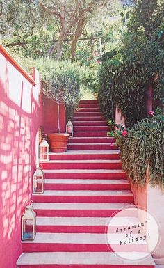 Pink stairs with lanterns on them.