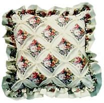 Image of a finished cathedral patchwork cushion