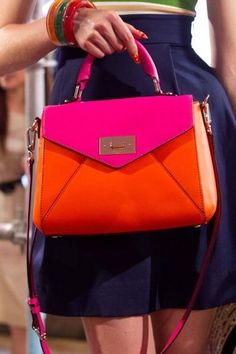 I love all of the bright pink and/or orange purses out this spring!! - MARC BY MARC JACOBS