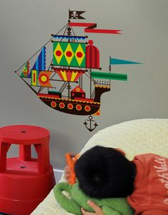 """When Patrick Hruby was he had a dream that he was part of the crew on a flying pirate ship. It probably had something to do with """"Hook"""" coming out that year, but it also made a great wall decal for Blik's 10 Year Birthday. Can you spot the on the sail? Boys Room Decor, Boy Room, Kids Room, Nautical Nursery, Nursery Art, Decor Crafts, Home Crafts, Magical Bedroom, Wooden Ship"""