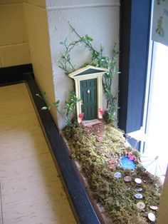 Stairwell fairy door - could work on any window sill, but I'll skip the indoor moss! Makes me think that spiders would be too cozy here!