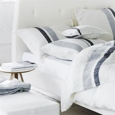 Even crisp white sheets can use an upgrade once in awhile. That's why we're loving Designers Guild's Sentier Alabaster Bed Linen. Stripes make everything better :)