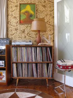 You can find old school record storage on Craig's List all the time.  Search furniture for records and LP's (vinyl returns too many irrelevant ads).