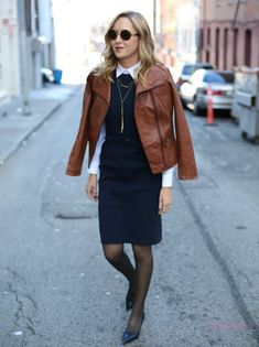 navy dress with button down shirt and leather jacket