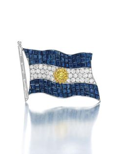 An Historic 'Mystery-Set' Sapphire, Diamond and Coloured Diamond Argentine Flag Brooch by Van Cleef & Arpels, formerly the property of Eva Peron. Bijoux Van Cleef And Arpels, Sapphire Color, Sapphire Diamond, New York October, Gold Texture, Love Blue, Colored Diamonds, Fashion Jewelry, Eva Peron
