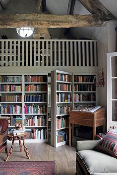 Love the hidden doors in the bookshelves! A Stone Cottage Filled with Books in the English Countryside