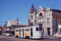 A four motor tram passing lovely old pub, Broadway Hotel on Logan Rd Woolloongaba , Brisbane. 1950's