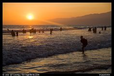 Sunset on beach shore, Santa Monica Beach. Santa Monica, Los Angeles, California, USA