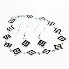 This distinctive bracelet and earring set, featuring a square rushnyk design, is handcrafted in .925 sterling silver and available in red, blue or pink.