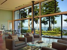 Location: Port Ludlow, Washington - The Port Ludlow House is a compact, 2400 SF modern house located on a wooded waterfront property at the north end of the Hood Canal, a long, fjord-like arm of… Minimalist Living Room, Ludlow House, House Styles, Floor To Ceiling Windows, Home Architecture Styles, Waterfront Homes, Port Ludlow, Minimalist Living Room Design, Great Rooms