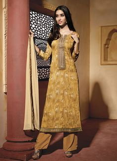 Include yourself in a glamour of a season with this yellow cotton satin designer suit. The fantastic attire creates a dramatic canvas with unbelievable embroidered and resham work. Comes with matching...