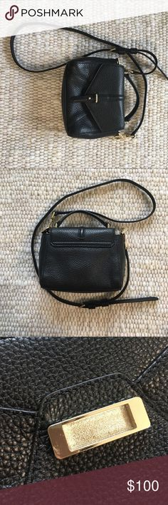 """Tory Burch 797 Tiny Satchel Black leather satchel with top handle and removable cross body strap. Magnetic closure (some scratches--see photo). Two interior slip pockets. Dimensions: 6""""w x 3""""d x 5"""" h; 2"""" handle drop; 23"""" strap drop. Used gently and in great condition!! Tory Burch Bags Crossbody Bags"""