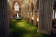 One of the largest gothic cathedral in Northern Europe hosted a fundraising dinneron June 8th to celebrate the Queen's Diamond Jubilee.  Yet the 900 guests must have been surprised when they entered York Minster in northern England to find the floor of the Cathedral transformed into a lawn. While workers laid down 16,000 square feet of fresh grass that covered the stone floor of the 14th century church, it appears that the job of mowing fell to the priests.