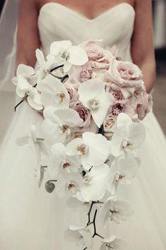 Elegant white orchid wedding bouquet; Featured Photographer: K&K Photography
