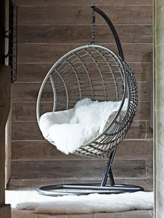 Made from durable materials that look just like light rattan, our impressive hanging chair has been intricately woven around a strong metal frame in a smooth round shape. Big enough to snuggle up with a book and glass of wine, our stylish chair includes a sumptuously filled cream armchair seat cushion and headrest that are easily removable for storage and washing. A four-legged metal stand is also included to allow you the choice to either hang the chair or place on the stand. As seen…